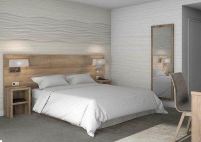 Llit i mobles d'habitació a un hotel